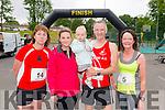 L-R Nora Flynn from Gneeveguilla, Lucy O'Sullivan from Killarney, Neasa O'Sullivan from Killarney, Jerry O'Connell from Mallow and Martina O'Connor from New Market at the finish line of Killarney Lions Club 10k run in aid of Kerry Spina Bifida Hydrocephalus Association in the Castle Ross Hotel, Killarney last Saturday morning.