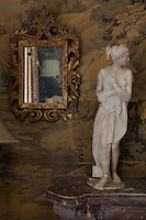 A nineteenth century marble beauty stands on the mantelpiece in the tapestry room