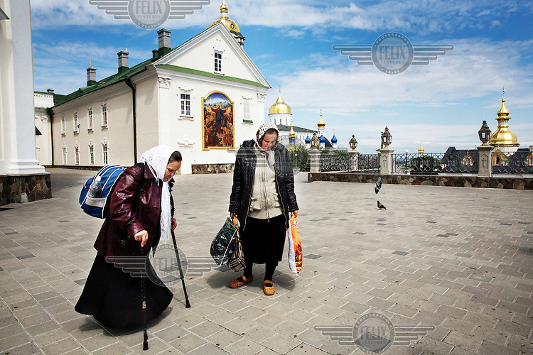 Pilgrims visit the holy formation of the Pochayiv monastery, the second largest Eastern Orthodox monastery in Ukraine.