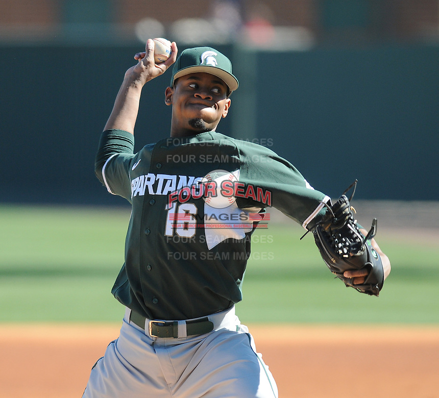 RHP David Garner (16) of the Michigan State Spartans pitches in a game against the Northwestern Wildcats on Sunday, February 17, 2013, at Fluor Field at the West End in Greenville, South Carolina. Garner was named to 2013 Big Ten Players to Watch. Michigan State won, 7-4. (Tom Priddy/Four Seam Images)