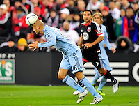 Sporting KC's Aurelien Collin headers the ball. Sporting Kansas City defeated D.C. United 1-0 during an MLS home opener at the RFK Stadium in Washington, D.C. on Saturday, March 10, 2012. Alan P. Santos/DC Sports Box