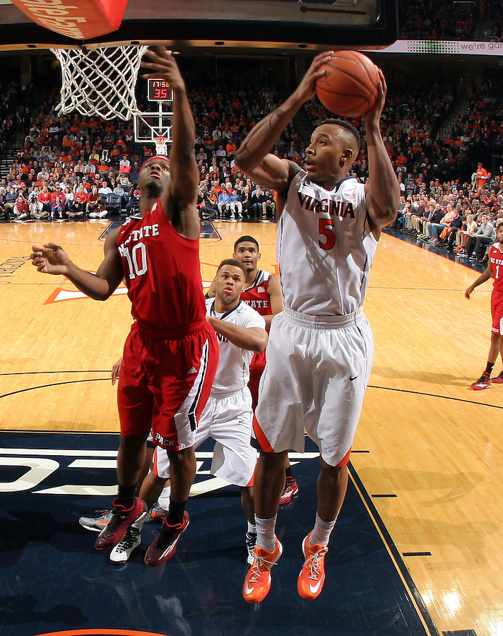 Virginia forward Darion Atkins (5) next to North Carolina State forward Lennard Freeman (10) during the game Jan. 7, 2015, in Charlottesville, Va. Virginia defeated NC State  61-51.