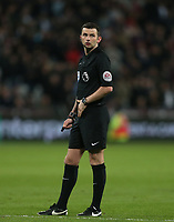 Referee Michael Oliver<br /> <br /> Photographer Rob Newell/CameraSport<br /> <br /> The Premier League - West Ham United v Stoke City - Monday 16th April 2018 - London Stadium - London<br /> <br /> World Copyright &copy; 2018 CameraSport. All rights reserved. 43 Linden Ave. Countesthorpe. Leicester. England. LE8 5PG - Tel: +44 (0) 116 277 4147 - admin@camerasport.com - www.camerasport.com