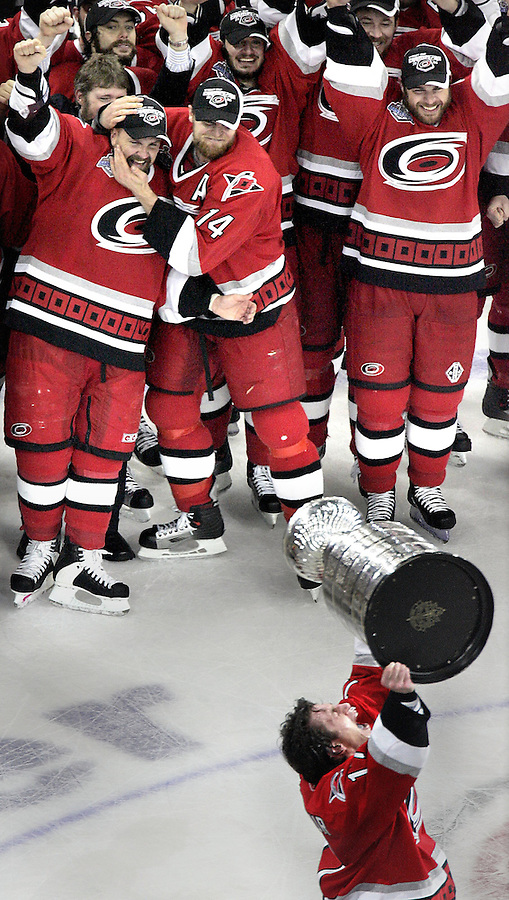 CUP7GM.SP.061906.EDR.JPG    Carolina Hurricanes captain Rod Brind'Amour hoists the Stanley Cup as his teammates watch after the Canes beat the Edmonton Oilers 3-1 in Game 7 of the Stanley Cup Finals at the RBC Center on Monday, June 19, 2006.  staff/Ted Richardson.