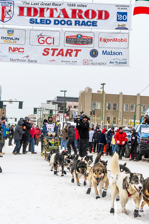 Dennis Kananowicz and team leave the ceremonial start line with an Iditarider and handler at 4th Avenue and D street in downtown Anchorage, Alaska on Saturday March 7th during the 2020 Iditarod race. Photo copyright by Cathy Hart Photography.com