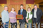 PRESENTATION: Hannah Lynch of the Tralee MS society presenting Tom Garvey of the Garvey's Supervalu, Tralee with a plaque in appreciation of generous sponsorship over the years at the Meadowlands hotel, Tralee on Monday l-r: Henry Burrows (chairman Tralee MS), Hannah Lynch  (treasurer Tralee MS),Tom Garvey, Catherine Dolan (secretary Tralee MS) and Ted Cronin (Garvey's)..