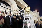 Palestinian President Mahmoud Abbas light a torch during a ceremony marking the 54th anniversary of Fatah's founding, in the West Bank city of Ramallah, on December 31, 2018. Photo by Thaer Ganaim