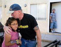 leaving0627 Rollie Rankin hugs Vanessa Sanchez, 10, shortly before she left Arizona for Pennsylvania. Rankin is the landlord and family friend.  (Pat Shannahan/ The Arizona Republic)