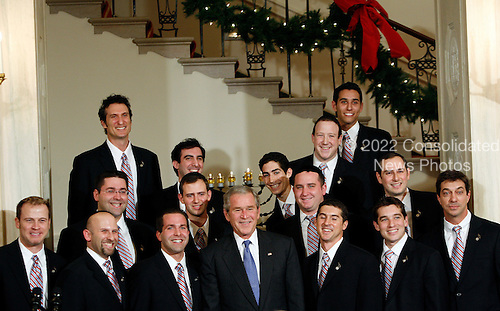 Washington, DC - December 15, 2008 -- United States President George W. Bush greets the Kol Zimra chorus after their performance   at the Hanukkah Reception in the Grand Foyer of the White House, Washington DC, Monday, December 15, 2008..Credit: Aude Guerrucci / Pool via CNP