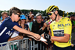 Race leader Yellow Jersey Greg Van Avermaet (BEL) BMC Racing Team signs autographs for young fans at sign before the start of Stage 8 of the 2018 Tour de France running 181km from Dreux to Amiens Metropole, France. 14th July 2018. <br /> Picture: ASO/Alex Broadway | Cyclefile<br /> All photos usage must carry mandatory copyright credit (&copy; Cyclefile | ASO/Alex Broadway)