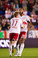 Thierry Henry (14) of the New York Red Bulls celebrates scoring with Dax McCarty (11) during the first half against the Columbus Crew during a Major League Soccer (MLS) match at Red Bull Arena in Harrison, NJ, on September 15, 2012.
