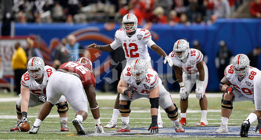 Ohio State Buckeyes quarterback Cardale Jones (12) gets ready for the snap with Ohio State Buckeyes offensive lineman Jacoby Boren (50), Ohio State Buckeyes offensive lineman Billy Price (54), Ohio State Buckeyes offensive lineman Taylor Decker (68) and Ohio State Buckeyes running back Ezekiel Elliott (15) during the second quarter in the Allstate Sugar Bowl college football playoff semifinal at Mercedes-Benz Superdome in New Orleans on Thursday, January 1, 2015. (Columbus Dispatch photo by Jonathan Quilter)