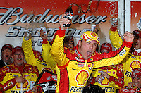 Kevin Harvick celebrates in victory lane after winning the Nextel Sprint Cup Series Budweiser Shootout at Daytona International Speedway in Daytona Beach, Fl. (The Florida Times-Union, Rick Wilson)