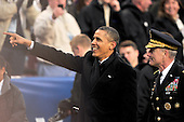 United States President Barack Obama gestures as he walks to the Army side of the field during halftime of the 112th meeting of the United States Army Black Knights and the U.S. Navy Midshipmen on the Navy side of the field at FedEx Field in Landover, Maryland on Saturday, December 10, 2011.  .Credit: Ron Sachs / CNP