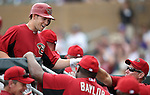 D'backs' Chris Owings is greeted in the dugout after hitting a home run in the eighth inning of a Cactus League preseason game between the Colorado Rockies and the Arizona Diamondbacks in Scottsdale, Ariz., on Monday, March 5, 2012. .Photo by Cathleen Allison
