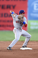 Auburn Doubledays second baseman Bryan Mejia (1) attempts to turn a double play during a game against the Batavia Muckdogs on June 14, 2014 at Dwyer Stadium in Batavia, New York.  Batavia defeated Auburn 7-2.  (Mike Janes/Four Seam Images)