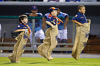 Three young Cub Scouts compete in the Bush's Baked Beans sack race between innings of the Southern League game between the Jackson Generals and the Tennessee Smokies at Smokies Park on April 14, 2012 in Kodak, Tennessee.  The Smokies defeated the Generals 5-2.  (Brian Westerholt/Four Seam Images)