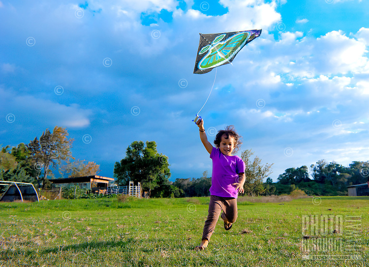 Young Hawaiian girl flying a kite