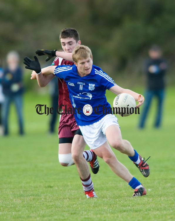 Tom Collins of Lissycasey in action against Podge Collins of Cratloe during their U-21 semi final at Gurteen. Photograph by John Kelly.