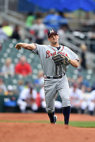Mississippi Braves third baseman Kyle Kubitza (39) throws to first during a game against the Montgomery Biscuits on April 22, 2014 at Riverwalk Stadium in Montgomery, Alabama.  Mississippi defeated Montgomery 6-2.  (Mike Janes/Four Seam Images)
