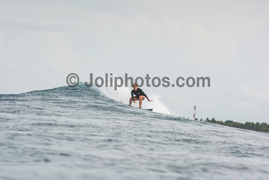 Four Seasons,Kuda Huraa, Maldives (Tuesday, August 4, 2015) The swell was out of the South East today with waves in the 3'-4' range and  slightly conditions. There was a surf session at Sultans this morning with Neco Padaratz (BRA), Sofia Mulanovich  (PRU), Brad Gerlach (USA), Harley Englby (AUS) and Shane Dorian (HAW), competitors in the Four Seasons Maldives Surfing Champions Trophy using the session s a warm up. There was a North West wind  early that swung towards the South during the day. There was also a session at Ninjas in the afternoon.  Photo: joliphotos.com