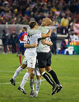 Tim Howard #1, Steve Cherundolo #6 and Carlos Bocanegra #3, celebrate after a 2-2 tie with Costa Rica to put the USA in first place of .CONCACAF 2010 World Cup qualifying, at RFK Stadium, in Washington DC, Wednesday, October 14, 2009.