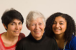 Three generations of same family: grandmother, mother, and teenage grandaughter portrait closeup horizontal biracial Caucasian and African American