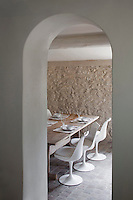 Glimpse through a narrow archway into the dining area