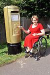 Tanni Grey Thompson, 11 time paralympic gold medallist,  painted  a post box gold in Stoke Mandeville on Tuesday 28th August2012  to mark the start of the Paralympic Games.