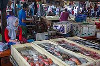 Bali, Indonesia.  Jimbaran Fish Market Vendors.