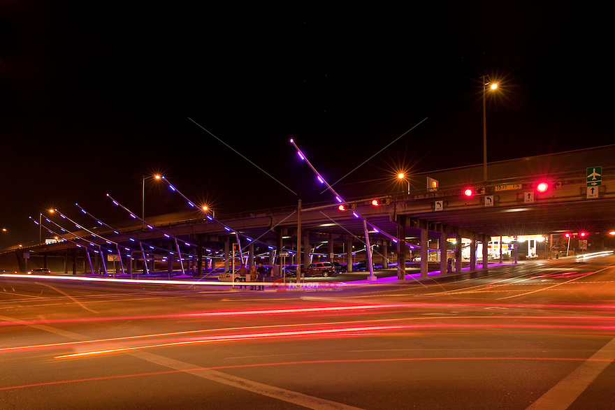 With bright neon purple and pink lights the IH-35 Makeover Project is a site to see and park in