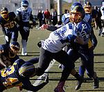 WATERBURY, CT - 23 NOVEMBER 2017 -112317JW02.jpg -- Kennedy High School #34 Nytoni Jones and #44 Angel Cruz tackle Crosby #23 Shamar Henry during the Thanksgiving Day Game at Municipal Stadium.  Jonathan Wilcox Republican-American