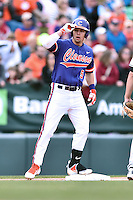 Clemson Tigers center fielder Chase Pinder (5) celebrates after hitting a triple during a game against the South Carolina Gamecocks at Fluor Field on March 5, 2016 in Greenville, South Carolina. The Tigers defeated the Gamecocks 5-0. (Tony Farlow/Four Seam Images)