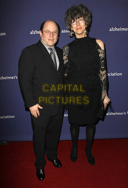 "JASON ALEXANDER & MADDIE CORMAN.18Th Annual ""A Night at Sardi's"" Benefitting The Alzheimer's Association held At The Beverly Hilton Hotel, Beverly Hills, California, USA..March 18th, 2010.full length black suit lace dress crochet sleeves married husband wife tall short.CAP/ADM/KB.©Kevan Brooks/AdMedia/Capital Pictures."