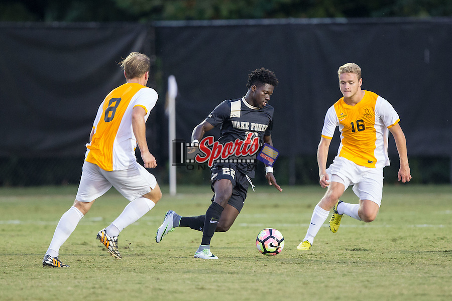 Ema Twumasi (22) of the Wake Forest Demon Deacons keeps the ball away from Jordan Melia (8) and Ian Bennett (16) of the Appalachian State Mountaineers during first half action at Spry Soccer Stadium on September 6, 2016 in Winston-Salem, North Carolina.  The Demon Deacons defeated the Mountaineers 3-0.   (Brian Westerholt/Sports On Film)