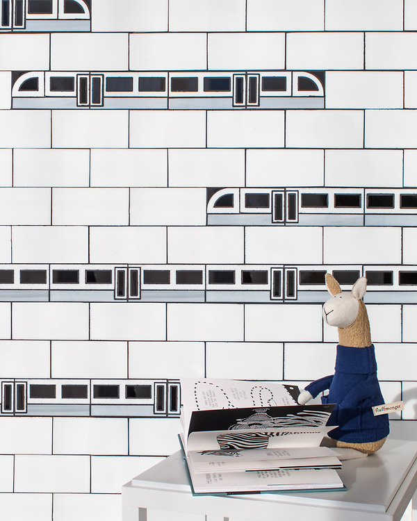 """Subway!, a waterjet jewel glass mosaic, shown in Absolute White, Obsidian, and Alabaster, is part of Cean Irminger's second KIDDO Collection, """"KIDDO: Wunderkammer® Edition"""" for New Ravenna.-Plush toys courtesy of Fluffmonger."""