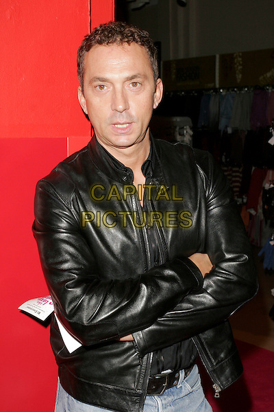 "BRUNO TONIOLI.Book Launch Party of ""The Lazy Goddess"", TK Maxx, Kensington High Street, London, England..September 9th, 2008.half length black leather denim arms crossed .CAP/AH.©Adam Houghton/Capital Pictures.."