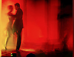 A couple dancing tango in a Buenos Aires nightclub.