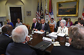 United States President Barack Obama, with US Vice President Joe Biden and former US Secretary of Health and Human Services Kathleen Sebelius, meet with insurance executives in the Roosevelt Room in the White House in Washington, DC on April 17, 2014. <br /> Credit: Molly Riley / Pool via CNP