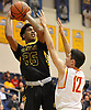 Tyrone Lyons #35 of St. Anthony's, left, shoots a jumper as Michael O'Connell #12 of Chaminade defends against him during the NSCHSAA varsity boys basketball final at Hofstra University on Tuesday, Feb. 27, 2018. Lyons recorded 11 points and 11 rebounds in the Friars' 63-60 win.