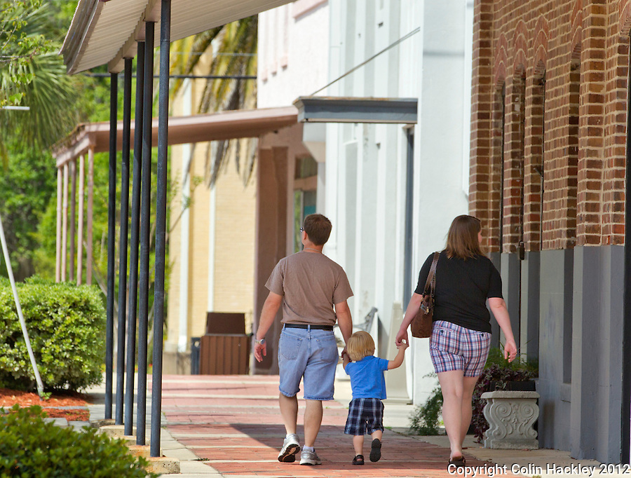 SLOWER PACE: A family walks the bricked sidewalks of downtown Madison. ..COLIN HACKLEY PHOTO