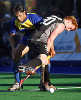 NZ's Ben Collier is tackled by Jivan Mohan during the international hockey match between the New Zealand Black Sticks and Malaysia at Fitzherbert Park, Palmerston North, New Zealand on Sunday, 9 August 2009. Photo: Dave Lintott / lintottphoto.co.nz