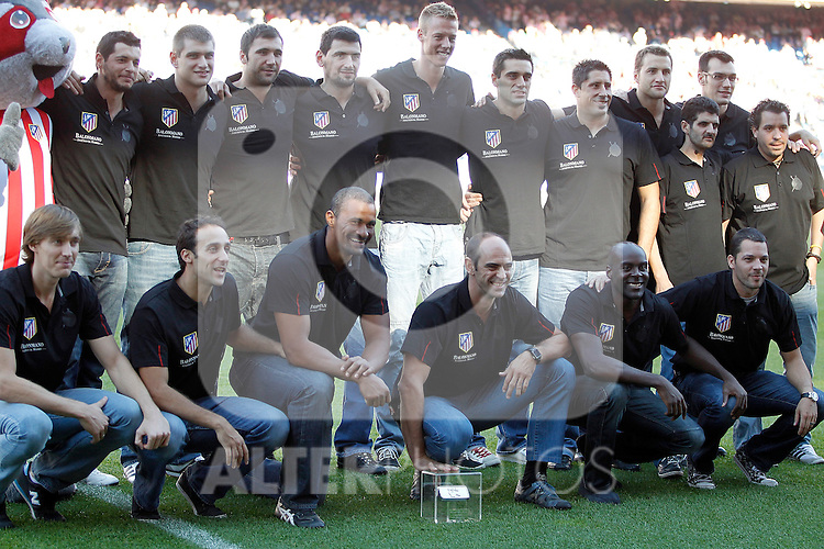 Atletico de Madrid's Hand Ball team offers Supercup trophy to fans before La Liga Match. September 18, 2011. (ALTERPHOTOS/Alvaro Hernandez)