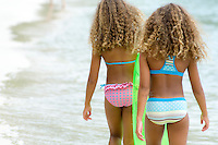 Twins enjoying a day at the beach<br />