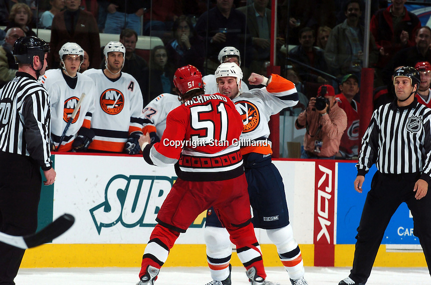 New York Islanders' Kevin Colley squares off with Carolina Hurricanes' Danny Richmond during their game Thursday, Jan. 19, 2006 in Raleigh, NC. Carolina won 4-3.