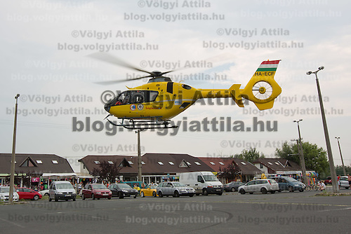 Rescue helicopter lands in a car park to help save a life in danger at Balatonlelle (about 140 km South-West of capital city Budapest), Hungary on July 18, 2015. ATTILA VOLGYI