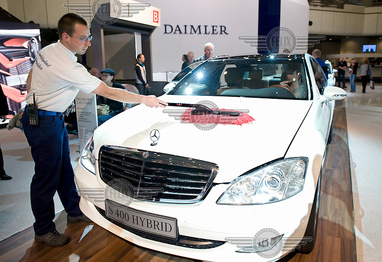 A man cleans a Mercedes S 400 car with Hybrid Blue Efficiency at the annual shareholders meeting of Daimler AG in Berlin.