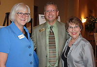 NWA Democrat-Gazette/CARIN SCHOPPMEYER Sally Conduff (from left), Phil Gelhausen and Karen Robbins help support the Single Parent Scholarship Fund of Benton County on Aug. 17.
