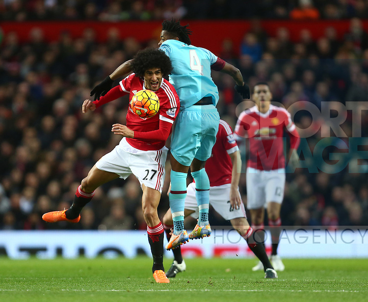 Marouane Fellaini of Manchester United battles West Ham's Alex Song in the air - Manchester United vs West Ham United - Barclay's Premier League - Old Trafford - Manchester - 05/12/2015 Pic Philip Oldham/SportImage