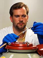 Technician in a sperm bank checking frozen samples.